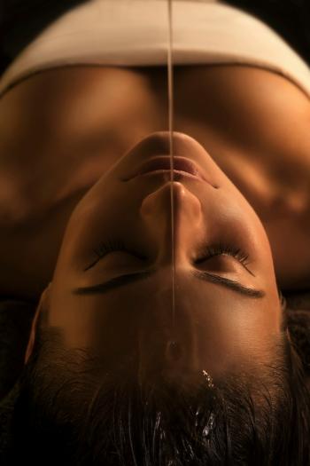 Shirodhara massage - close-up