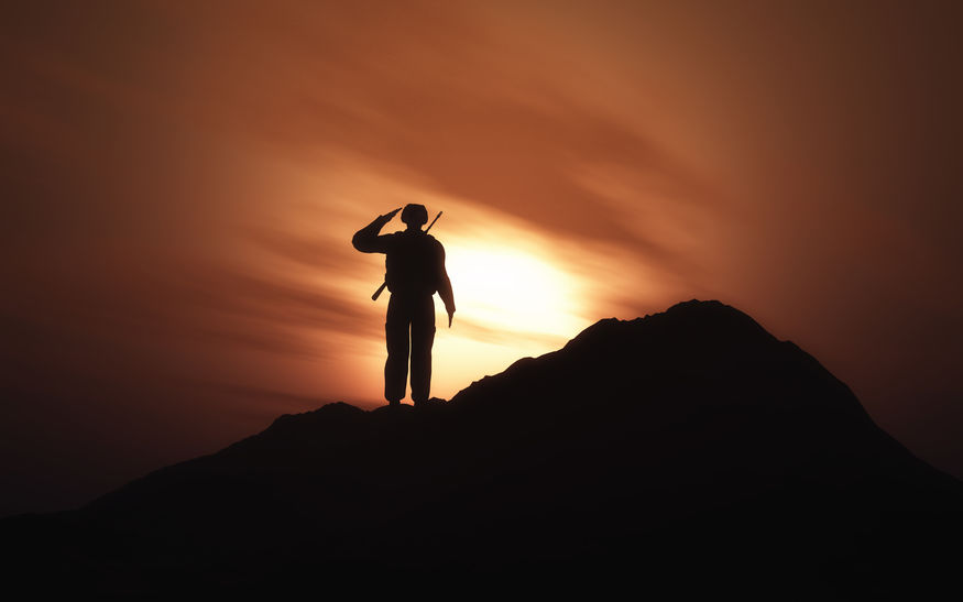 3D silhouette of a soldier saluting against a sunset sky